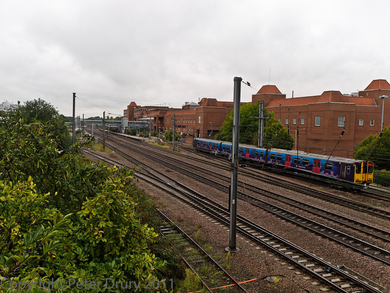 04 Aug 2011. Class 313 EMU moving from the stabling point to the station to prepare for a local service to London Kings Cross.