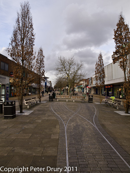 14 February 2011. The main precinct (was the old London Road (North). Copyright Peter Drury 2011<br /> The 'rails' in the precinct are a reminder of the Horndean Light Railway (a tramway) which passed through here.