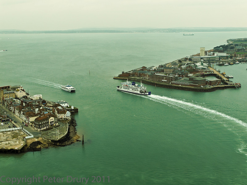 01 Mar 2011 Views from the Spinnaker Tower. The narrow neck of the harbour entrance with the car ferry and hydrofoil passing, in their journey between Portsmouth and the IOW.
