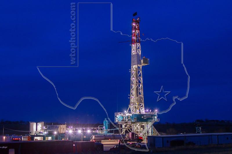 Trinidad Rig Drilling Eagle Ford Shale Well at Dusk<br /> near Nordheim, TX