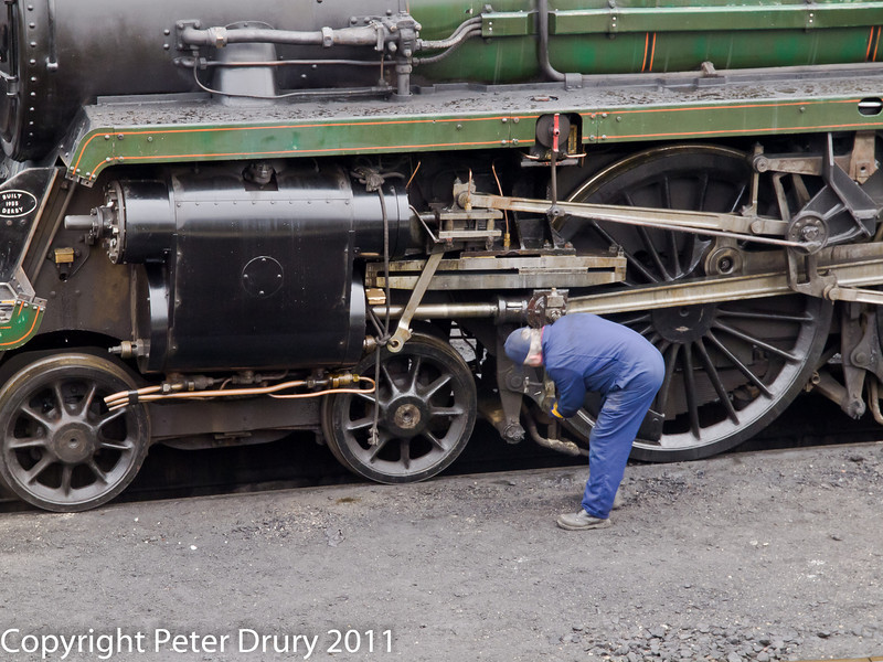 26 January 2011. Ropley:- 73096 BR Class 5MT awaiting next duty.  Copyright Peter Drury 2011<br /> Fitter adjusting Brake shoes.
