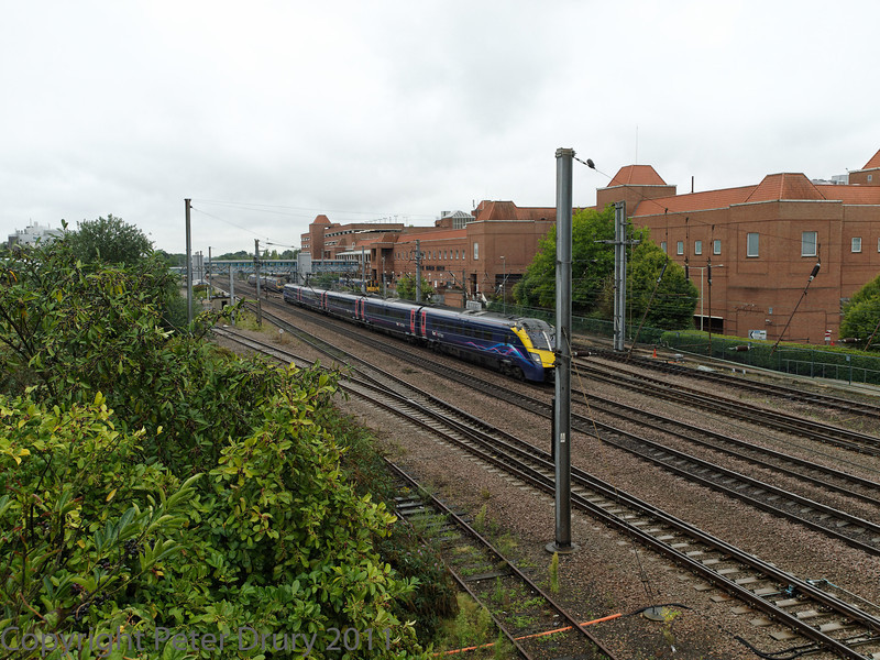 04 Aug 2011. Voyager passing through the station on the fast line.