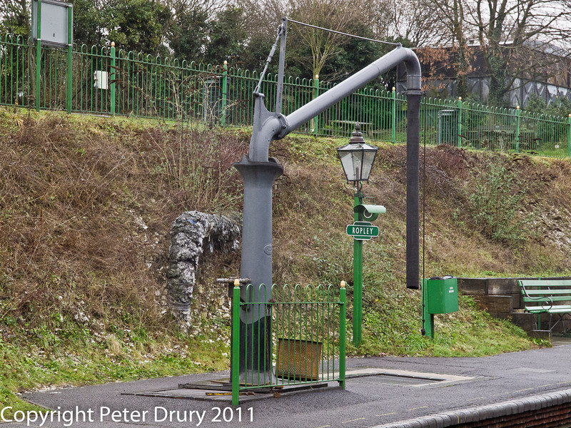26 January 2011. Ropley:- Water crane on the Up platform.  Copyright Peter Drury 2011<br /> Used frequently on running days. The water pressure is maintained by the storage tank in the shed area.