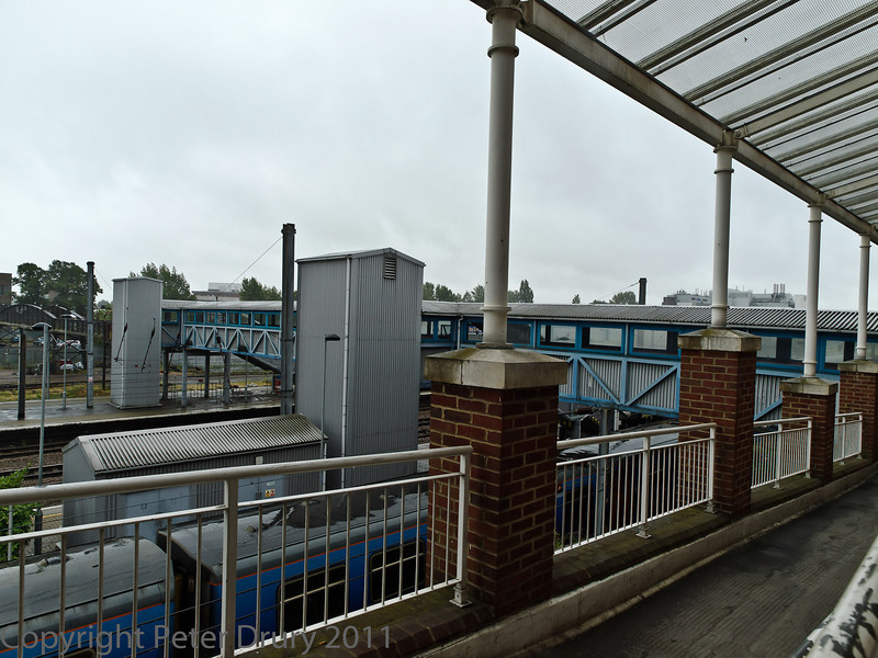 04 Aug 2011. Passing through the ticket hall, you arrive at a balcony overlooking the station and a covered footbridge leading to the platforms.