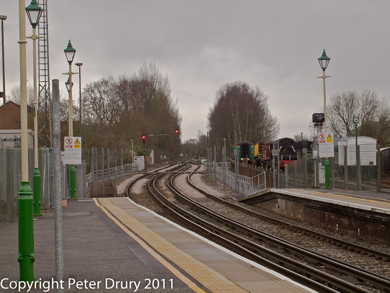 26 January 2011. Alton:- London end.  Copyright Peter Drury 2011<br /> The two lines on the left are part of the National Network. They are connected to the single line section just beyond the signals. Behind the fence and to the right is the Head Shunt and sidings belonging to the Mid Hants Railway.