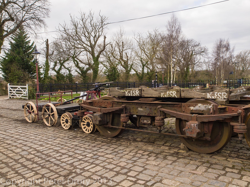The cobbled approach to the carriage works with a coach bogie awaiting rebuild and platelayers trucks outside.