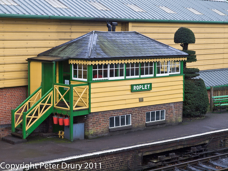 26 January 2011. Ropley:- Station signal box.  Copyright Peter Drury 2011<br /> The point rodding and signal wires can be seen emerging from the platform front directly in front of the signal box.