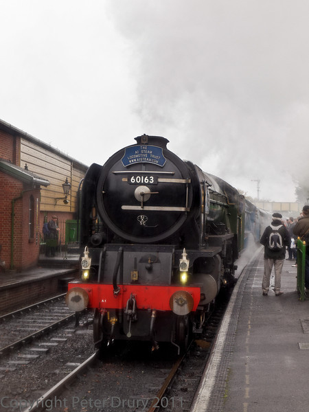 30 Oct 2011 Super power in the form of Tornado and Dominion of New Zealand, heading a service from Alresford, arrives in the up platform at Ropley.
