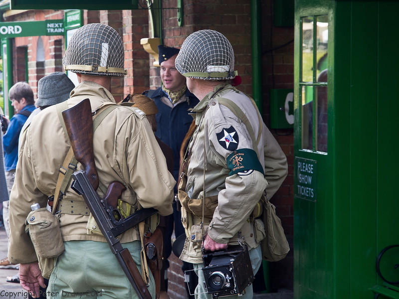 11 Jun 2011. War on the Line, Ropley Station scenes. Copyright Peter Drury 2011<br /> American soldier and cameraman at the station entrance.