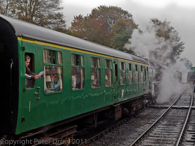 30 Oct 2011 LMS Class 5 standing in the up platform line with Lord Nelson (seen behind the smoke and steam)drawing foreward to double head the train to Alton..
