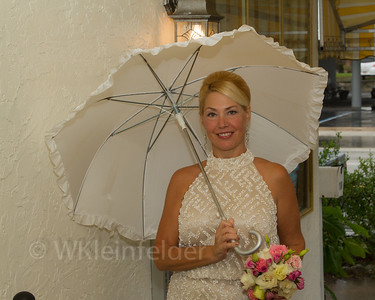 Though the wedding was beautiful the weather was not. This was Kim arriving. www.wklein.smugmug.com