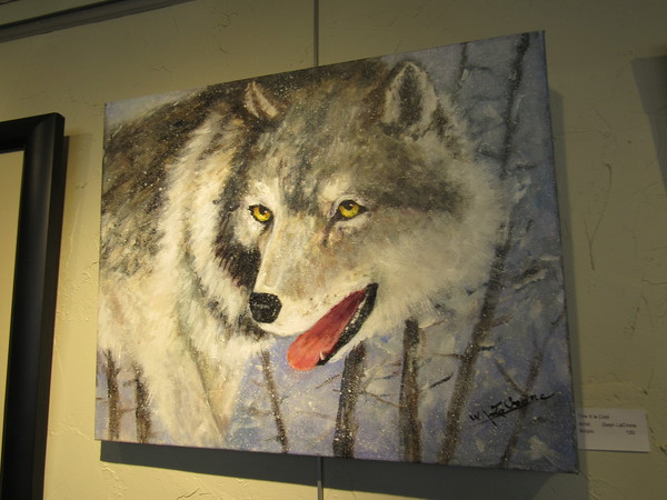 Staff photo by Cathy Spaulding<br /> Gwyn LaCrone says she enjoys painting animals, including wolves.