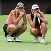 Phoenix special photo by Von Castor<br /> Kenzie Kirkhart, right, studies a putt with her caddie, Katie Kirkhart, in the WOGA State Girls Tournament Tuesday at Muskogee Golf and Country Club. Kenzie is a sophomore to be at Hilldale, where Katie graduated last year and will play golf at Oral Roberts in 2016-17.