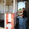 Staff photo by Cathy Spaulding<br /> Fort Gibson Police Chief Donnie Yarbrough lathers up a roasting trailer to be used Saturday at the Fort Gibson Sweet Corn Festival. People can buy corn by the ear or by the bushel.