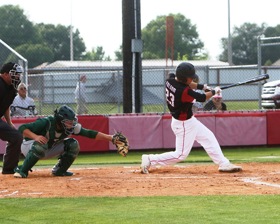 Special photo by John Hasler<br /> Hilldale's Dalton Folsom rips a single in the second inning that Adair's Alec Brand, left, watches, scoring Kort Morgan to give the Hornets a 3-0 lead. Hilldale would go on to win the game 7-1.