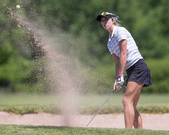 Special photo by Von Castor<br /> Hilldale's Katie Kirkhart blasts out of the bunker on the 15th hole at Lake Hefner South Golf Course in the first round of the Class 4A girls state golf championship Wednesday in Oklahoma City. Kirkhart is defending champion.
