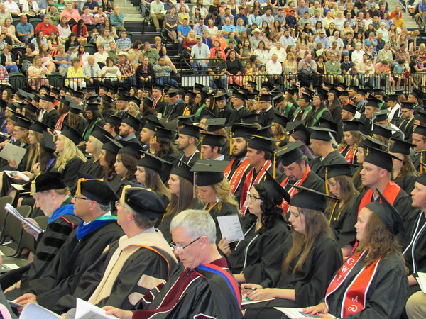"""Staff photos by Cathy Spaulding<br /> Faculty and graduates of the Northeastern State University Colleges of Business & Technology and Liberal Arts form what NSU President Dr. Steve Turner called a """"panorama of spring colors"""" Saturday during commencement ceremonies. It was NSU's third commencement ceremony of the weekend."""