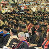"Staff photos by Cathy Spaulding<br /> Faculty and graduates of the Northeastern State University Colleges of Business & Technology and Liberal Arts form what NSU President Dr. Steve Turner called a ""panorama of spring colors"" Saturday during commencement ceremonies. It was NSU's third commencement ceremony of the weekend."