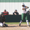 Special photo by John Hasler<br /> Muskogee's Elexis Watson, right, cranks out one of her two home runs on Saturday in the championship game of the Muskogee-Tahlequah Slug-Out tournament at Muskogee High School. Watson led the Lady Roughers with seven runs batted in as Muskogee beat Broken Arrow 21-19.