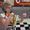 Staff photo by Cathy Spaulding<br /> Fort Gibson Community Education Director Sheilah Yarbrough calls out a winning ticket during a recent Golden Agers Breakfast. The breakfast is an annual event sponsored by the community education program.