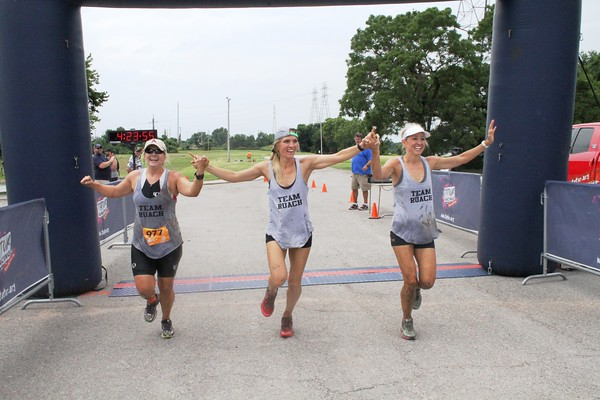 Special photo by John Hasler<br /> Amy Daniel, left, Lindsey Berg, and Laura Jones of Arkansas win the female long course race.