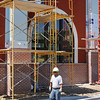 Staff photo by Harrison Grimwood<br /> Employees of R.B. Weatherman Masonry put up scaffolding outside Muskogee Little Theatre's new facility as they wrap up work on the facade of the multimillion-dollar downtown project.