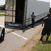 Staff photo by Harrison Grimwood<br /> A Muskogee wrecker service worked through Tuesday afternoon to remove a tractor-trailer rig from U.S. 62, just west of the Muskogee Turnpike. Muskogee Police Officer Tyler Evans said the tractor-trailer rig, driven by Salome Martinez-Martinez of Texas, was westbound on U.S. 62 when a brake line on the trailer blew out, and the trailer's<br /> rear axle slid out from under the trailer. Evans said the trailer swung out toward the ditch before the rig came to a stop. It was hauling 44,000 pounds of Gatorade, he said. There were no injuries; nor was the driver cited, Evans said.