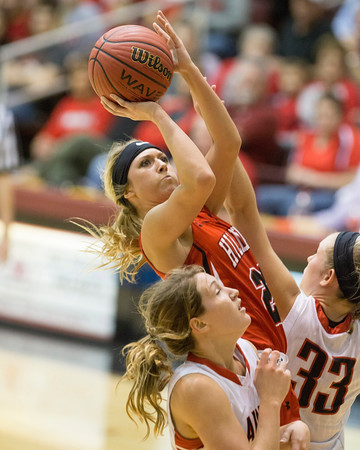 Special photo by Von Castor<br /> Hilldale's Katie Kirkhart gets a bucket in the lane over Plainview's Rebecca Wright, right, and Abby Bilsbury, bottom, during the Class 4A state quarterfinals on Thursday at Southern Nazarene University.