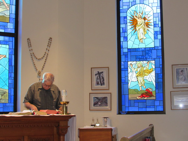 Staff photo by Cathy Spaulding<br /> Ed Falleur prepares the reading for a daily mass at St. Joseph Catholic Church. Falleur has a lifelong devotion to the faith.