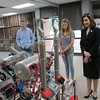 Staff photo by Cathy Spaulding<br /> State Superintendent of Public Instruction Joy Hofmeister, right, looks at a robot made by Fort Gibson High School's Hostile Gato robotics program. Program coach Tim Berres and FGHS junior Karlie Taylor explain how the robot works.
