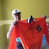 Staff photo by Cathy Spaulding<br /> Moton School graduate Lelia Davis displays an orange jacket worn by Panther basketball team members. Davis said she expects Moton graduates to come to Taft for Memorial Day weekend celebration.