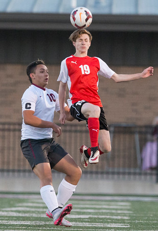 Special photo by Von Castor<br /> Hilldale's Matthew Clabaugh, right, beats Wagoner's Braulio Aguilar for a header Monday night at Wagoner. The Bulldogs defeated the Hornets 6-5 in penalty kicks after the score was tied 2-2 at the end of regulation and overtime.