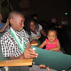 Staff photo by Cathy Spaulding<br /> Cherokee Elementary fifth-grader Jay'Lan Anderson shows his honors certificate to his sister, Tanylah Maxwell, 1. Jay'Lan received the certificate Thursday night at the Academic Honors Awards Program.