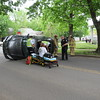 Staff photo by Cathy Spaulding<br /> Muskogee police, firefighters, and Emergency Medical Service medics investigate a Toyota that turned on its side after hitting a tree Monday afternoon. Officer James Moore said Carol Garner, 68, of Muskogee was driving a 2011 Toyota Camry northbound on East Side Boulevard when the car hit a tree south of Lawrence Street shortly after noon. Moore said Garner was not injured. He said she was wearing a seat belt, but the air bag did not deploy.