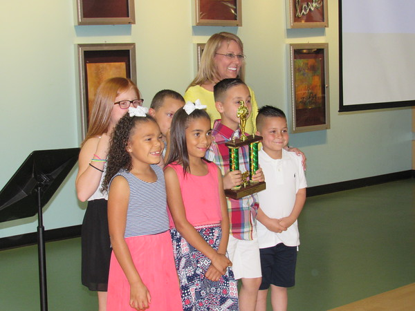 Staff photo by Cathy Spaulding<br /> Grant Foreman Elementary students, front row from left, Samarah Dansberry, Aniyah Dansberry, Cruz Colina and Xavi Colina; back row from left, Kensley Allen, and Arthur Dansberry join school counselor Joanne Myers in accepting the trophy for Best Video.