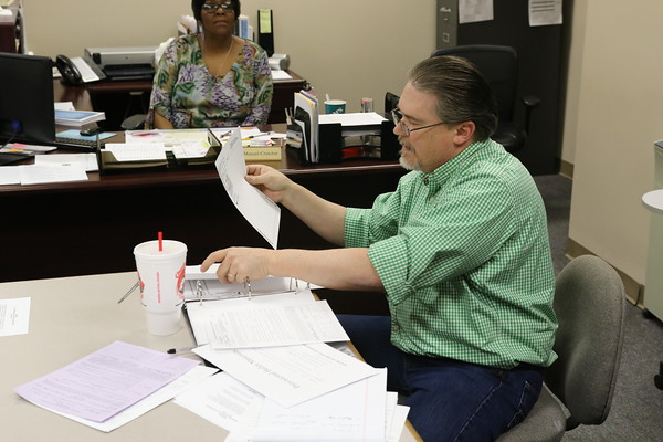 Staff photo by Harrison Grimwood<br /> Muskogee County Election Board Secretary Kelly Beach, right, opens the provisional ballot that tied the outcome of the Muskogee Board of Education runoff election between challenger Bobby Jefferson and the incumbent, John Barton.