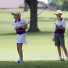 Phoenix special photo by Von Castor<br /> Brianna Bryson hits her tee shot on the second hole at Muskogee Golf and Country Club on Sunday afternoon as her teammate Trapper Green watches. The two were part of the club's junior team involved in match play against a team from Southlakes Golf Course in Jenks.