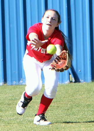 Phoenix special photo by John Hasler<br /> Fort Gibson left fielder Makenzie Austin lunges for and catches a ball for an out in a doubleheader sweep of Oktaha on Thursday.