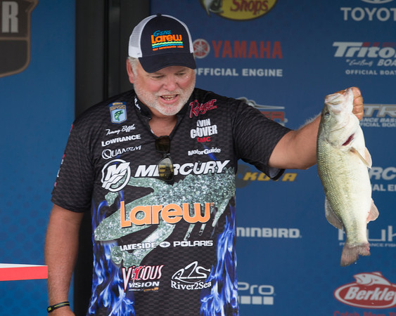 Special photo by Von Castor<br /> Tommy Biffle of Wagoner shows one fish he landed during first-round weigh-ins in the Bassmaster Bass Pro Shops Central Open #1 at Three Forks Harbor.