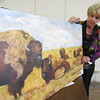 Staff photo by Cathy Spaulding<br /> Gwyn LaCrone shows a painting of a bison herd. She uses all sorts of paints and mediums.