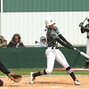 Phoenix special photo by John Hasler<br /> Westmoore's Kendra Hall, left, reaches for a pitch that Muskogee's Carlee Gann sends over the fence for a home run as Gann's teammate Elexis Watson looks on during Friday's action in the Muskogee Slug-Out.