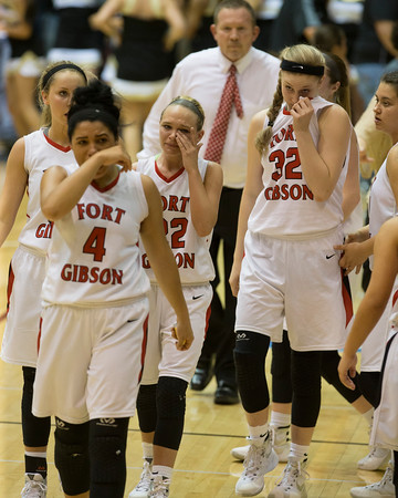 Special photo by Von Castor<br /> Fort Gibson's Alexis Wright, left, Carlee Fryar, center, and Danielle Johnson wipe away tears following the Lady Tigers' 47-43 loss to Broken Bow in Thursday's Class 4A quarterfinal at Southern Nazarene University.