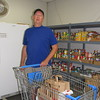 Staff photo by Cathy Spaulding<br /> Tom Carment got involved with Muskogee Community Pantry after retiring from Rogers State University last year. He is the pantry's vice president and coordinator.