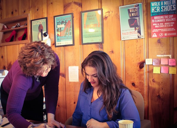 Photo by Keri Parish<br /> Help-In-Crisis director Margaret Cook and victim's services coordinator Jennifer Warford-Pettus go over plans for the next Walk a Mile meeting. Planning for the event takes months, and weekly meetings ensure everything is going correctly and smoothly.