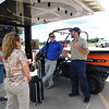 KENTON BROOKS/Muskogee Phoenix<br /> Assistant driver mechanic George Scoumis of Wilkesboro, N.C., far left, talks with Donnie Nix of South Carolina and Jay and Martha Swinney in the Southeast Baptist Church parking lot prior to helping flood victims in Webbers Falls and Fort Gibson. The Samaritan's Purse and Billy Graham Evangelist Association Rapid Response Team showed up Friday to help an estimated 300 families affected by the flood.