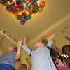 Staff photo by Cathy Spaulding<br /> Early Childhood Center pupils point to plastic plates they painted and had installed on the ceiling. The project was modeled after ceiling art by artist Dale Chihuly.