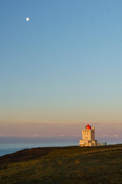 Sunrise over the lighthouse at Dyrhólaey near Vik, Iceland.