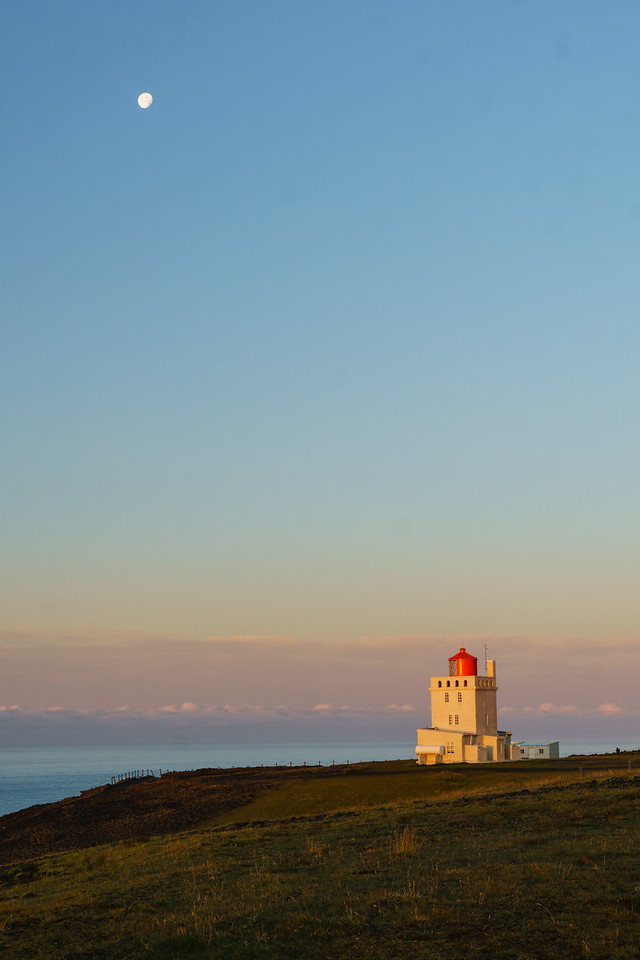 Sunrise over the lighthouse at Dyrhólaey near Vik, Iceland.