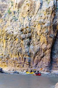 Packrafters floating through the impressive narrows of Muddy Creek in Utah.