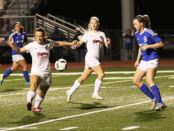 Phoenix special photo by John Hasler<br /> Fort Gibson's Brooke Hatchette takes a shot on goal as Porter's Shelby Gaston defends. Fort Gibson won the Class 4A playoff game in a shootout.